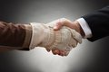 Worker shaking hand with businessman Royalty Free Stock Photo