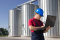 Worker in silo company working on the laptop Stock Photos