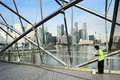 Worker in singapore may cleaning the helix bridge front of downtown the helix is fabricated from tonnes of duplex Royalty Free Stock Photography