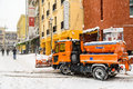 Worker Snow Plow Truck During Heavy Snow Storm In Downtown Bucharest City