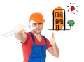 Worker with spanner showing thumbs up sign portrait of happy Stock Image