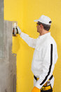 Worker spreading a plaster on a corner wall construction Royalty Free Stock Photo