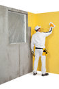 Worker spreading a plaster on a wall construction Royalty Free Stock Images