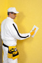 Worker spreading a plaster on a wall construction Stock Photography