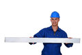 Worker stood with metal bean construction beam Royalty Free Stock Images