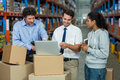 Worker team looking a laptop put on a cardboard box Royalty Free Stock Photo