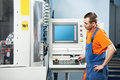 Worker at tool workshop mechanical technician working cnc milling machine center in Royalty Free Stock Photo