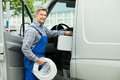 Worker With Toolbox And Cable Entering In Van Royalty Free Stock Photo