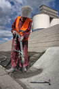Worker on top of hale is spraying concrete renewing roof industrial with sprayed Royalty Free Stock Image