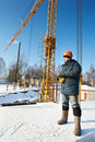 Worker with tower crane remote control equipment Stock Photos