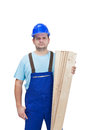 Worker in uniform holding wooden planks Royalty Free Stock Image