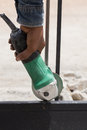 Worker using an angle grinder to grinding door frames Royalty Free Stock Photo