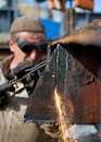 Worker using a propane torch Stock Image