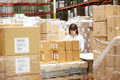 Worker in warehouse preparing goods for dispatch female Royalty Free Stock Images