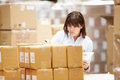 Worker in warehouse preparing goods for dispatch female Stock Image