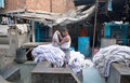 Worker washing clothes at Dhobi Ghat in Mumbai, India Royalty Free Stock Photo