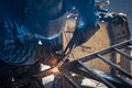 Worker welding metal with protective mask Royalty Free Stock Image