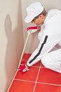 Worker wrapped with masking tape red tiles Stock Photography