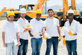 Workers at a building site group of looking happy Stock Images