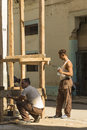 Workers building wooden scaffold Havana Royalty Free Stock Photo