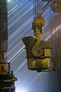 Workers cater for equipment in the steel producing workshop Stock Images
