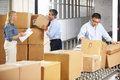 Workers checking goods on belt in distribution warehouse male and female Royalty Free Stock Images
