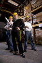 Workers with female boss in storage warehouse Royalty Free Stock Image