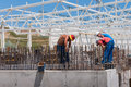 Workers on fish farm tank construction site Royalty Free Stock Photos