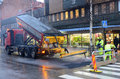 Workers Laying Asphalt