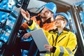 Workers in logistics warehouse checking the inventory Royalty Free Stock Photo