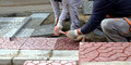 Workers paving  walkway Royalty Free Stock Photo