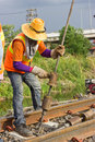 Workers preparing equipment for maintenance of the railway edit Royalty Free Stock Image