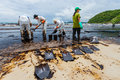 The workers from ptt use the shovel to remove the crude oil rayong thailand july on spill accident by on ao prao beach at Stock Image