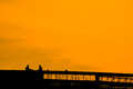 Workers relax the are on the sunset background silhouette Stock Photo