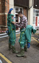 Workers removing decontamination suits Royalty Free Stock Photo