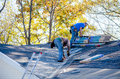 Workers Repairing a roof Royalty Free Stock Photo