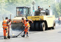 Workers repairs road Royalty Free Stock Images