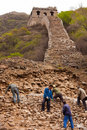 Workers repairs the ruins of the Great Wall Stock Images