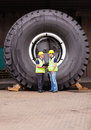 Workers standing tire cheerful warehouse in front of huge Royalty Free Stock Image
