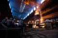 Workers in a steel Factory Royalty Free Stock Photo