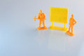 Workers toy and blank yellow signage.jpg Royalty Free Stock Photo