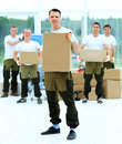 Workers unload boxes in the office Royalty Free Stock Images
