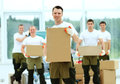 Workers unload boxes in the office Royalty Free Stock Photos
