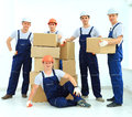 Workers unload boxes on a white background Stock Photos