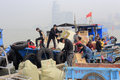 Workers unloading from wooden motorized boat amoy city china Stock Photo