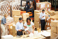 Workers In Warehouse Preparing Goods For Dispatch Royalty Free Stock Photo