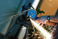 Working with angle grinder Stock Photography