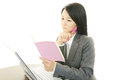 Working asian business woman sitting at desk on laptop Stock Photos