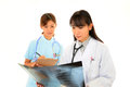 Working Asian female doctor with nurse Stock Photo