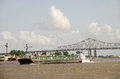 Working barge on mississippi river steel with railroad bridge and blue sky Stock Photos